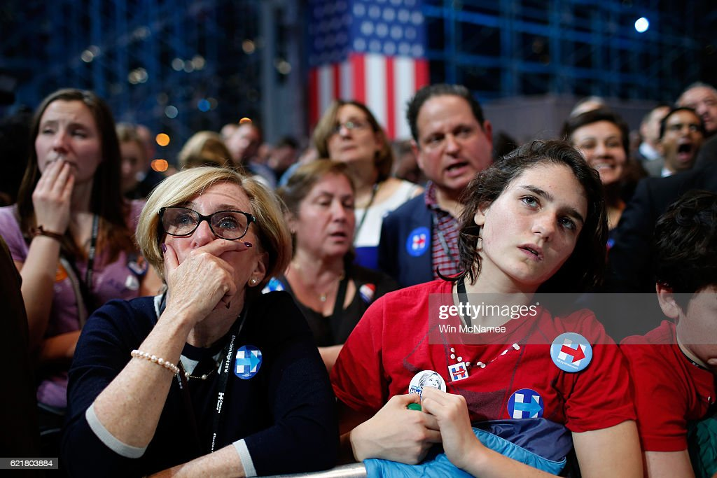 People watch voting results at Democratic presidential nominee former Secretary of State Hillary Clinton's election night event at the Jacob K. Javits Convention Center November 8, 2016 in New York City. Clinton is running against Republican nominee, Donald J. Trump to be the 45th President of the United States.