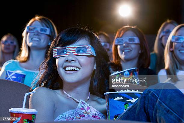 people watching 3-d movie - redoubtable film stock photos and pictures