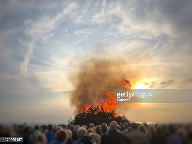 people watching a bonfire on the beach at midsummer, fanoe, denmark - tradition stock pictures, royalty-free photos & images
