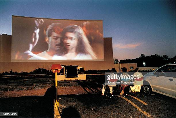People watching a film at Prarthana DriveIn Beach Theater January 2000 in Chennai India Chennai's Prarthana DriveIn Beach Theater is the only one in...