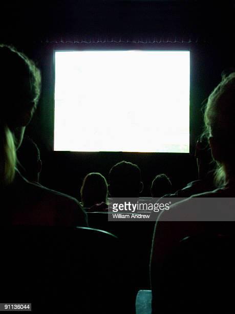 People Watching a Glowing Screen