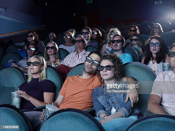 People watching a movie at a theater