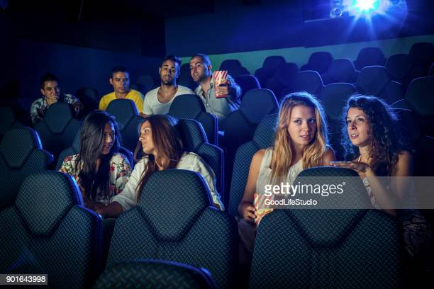 people watching a movie in a cinema - adult film stock photos and pictures