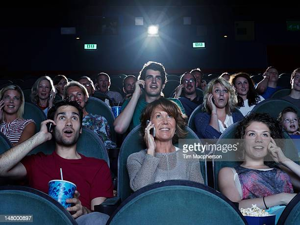 people watching a movie on the phone - audience stock pictures, royalty-free photos & images