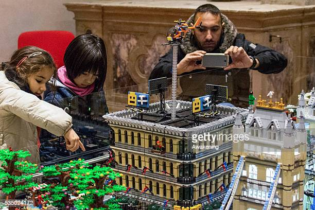 People watching at the constructions made with Lego In the San Gregorio Church on december 2015 an exposition of Lego buildings on the occasion of...