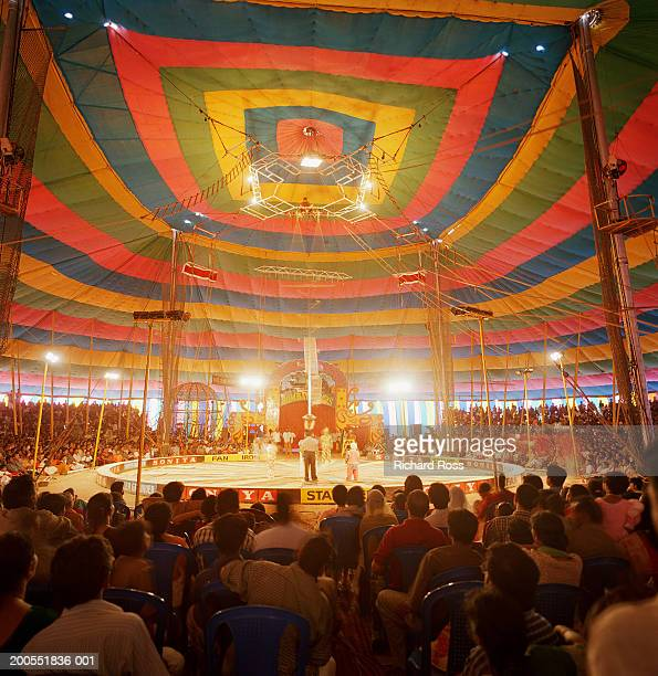 people watching circus in tent - circus stock pictures, royalty-free photos & images