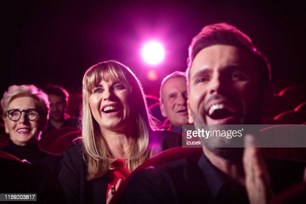 people watching comedy movie in theater - film screening stock pictures, royalty-free photos & images
