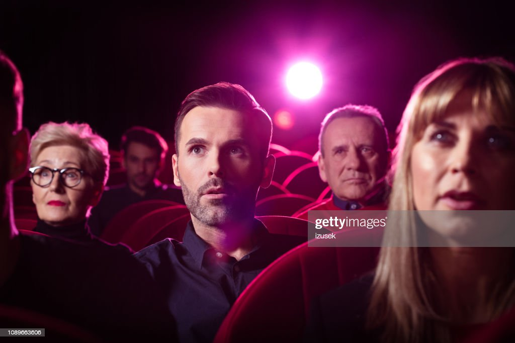 People watching crime film in the cinema : Stock Photo
