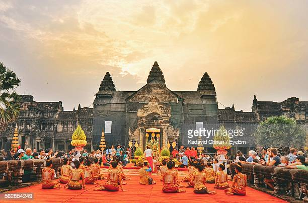 people watching dancers at angkor wat temple - apsara stock photos and pictures