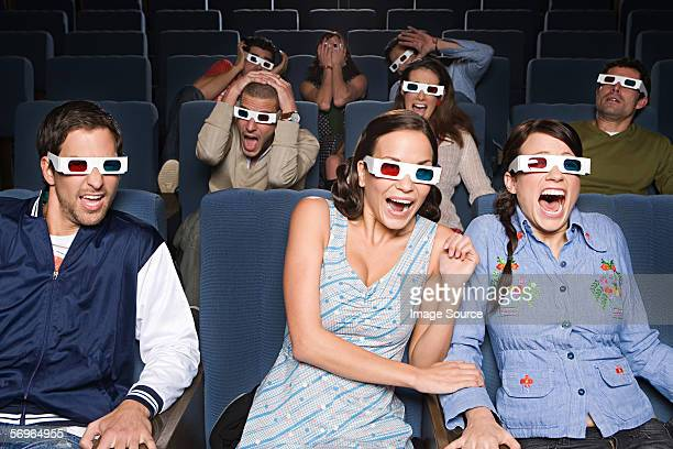 People watching exciting 3D movie