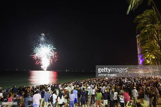 People watching fireworks at sea