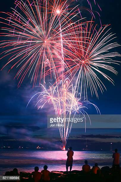 people watching fireworks from lahaina harbor - lahaina stock pictures, royalty-free photos & images