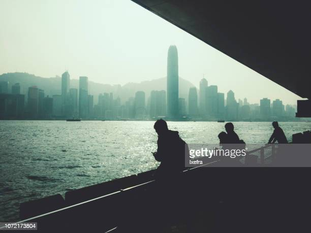 People watching Hongkong skyline, from Kowloon.