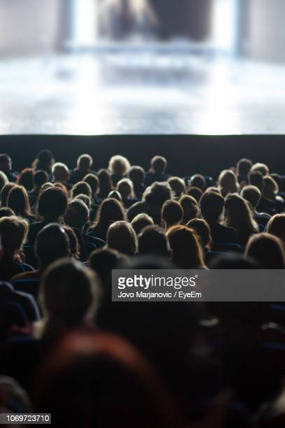 people watching movie in theatre - movie theater stock pictures, royalty-free photos & images