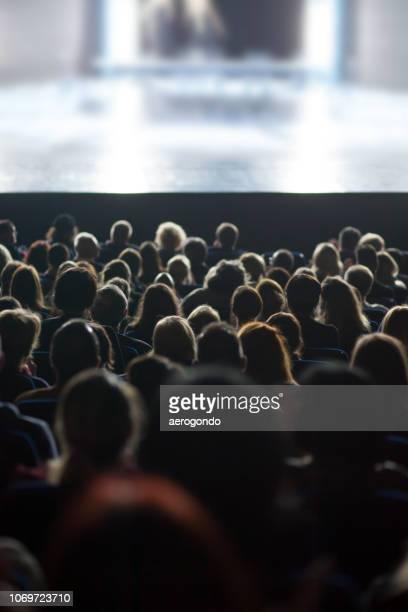people watching movie in theatre - projektionswand stock-fotos und bilder