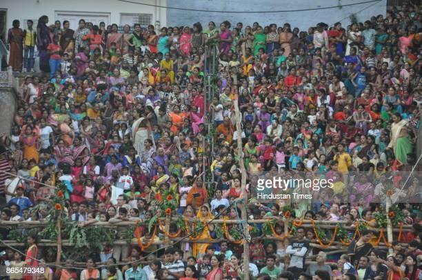 People watching Nag Nathaiya festival celebrations at Tulsi Ghat on October 23 2017 in Varanasi India Nag Nathaiya festival was first started in the...