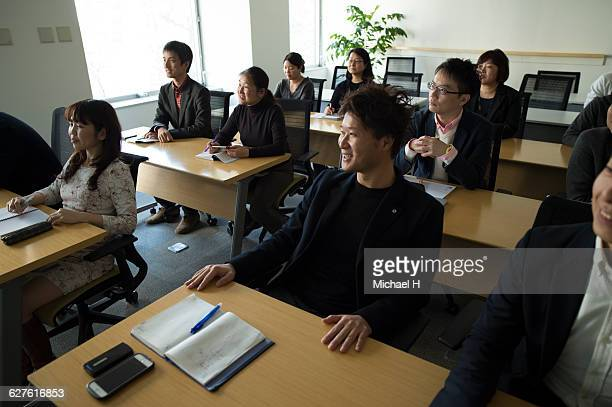 people watching presentation in conference room