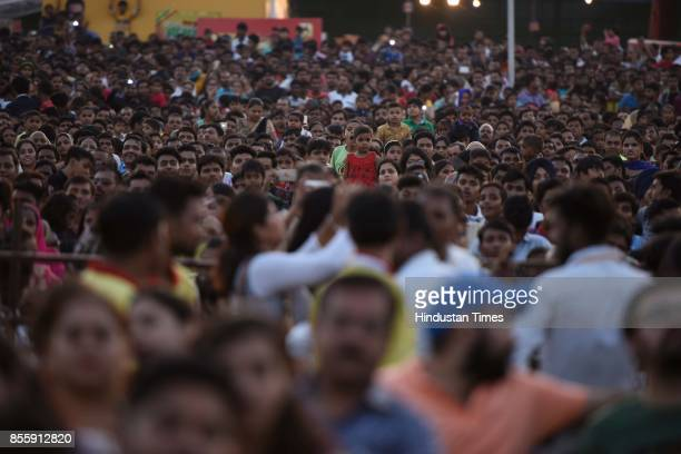 People watching Ramlila as artists perform during the Dussehra festival celebration at Lal Quila Grounds on September 30 2017 in New Delhi India...