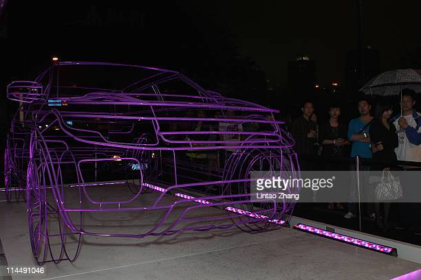 People watching Range Rover Evoque wireframe at outside Waterhouse on May 21 2011 in Shanghai China