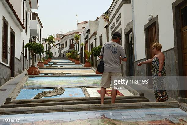 People watching relief models of canary islands (Firguas Gran Canaria)