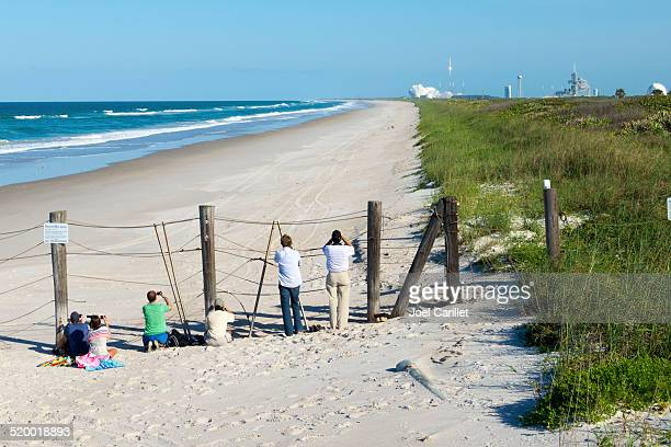 people watching rocket launch at canaveral national seashore - titusville florida stock pictures, royalty-free photos & images