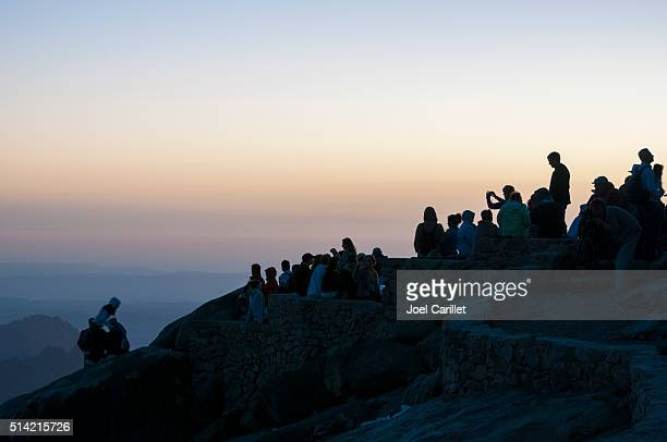 people watching sunrise on mount sinai, egypt - mt sinai stock photos and pictures