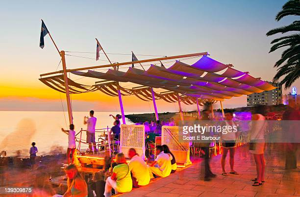 people watching sunset. café del mar, san antonio - ibiza island stock pictures, royalty-free photos & images