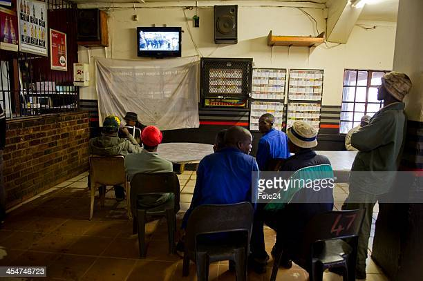 People watching the memorial service on their home television at Onverwacht on December 10 in Pretoria South Africa The Father of the Nation passed...
