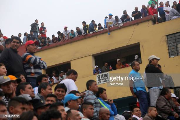 People watching the street football match from the building in Lima Peru May 1 2017 For 64 years every May 1st is celebration the Mundialito de El...