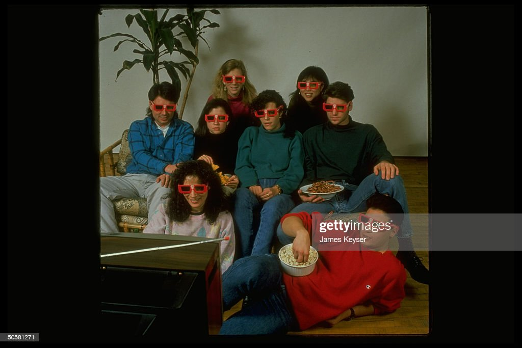 People watching TV demonstrating the use of 3-D glasses which will be worn by viewers during halftime show of the Superbowl.;1989