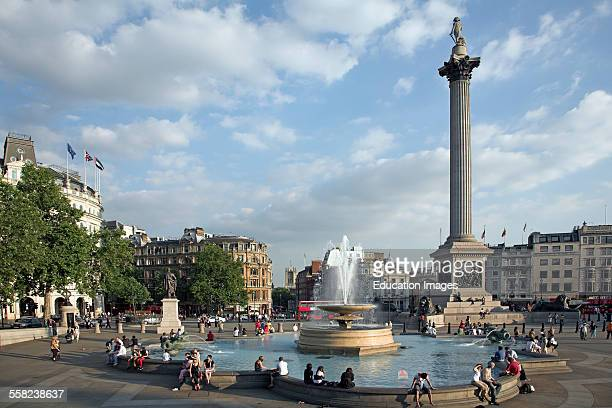 People water fountain and Nelsons column in Trafalgar Square London England