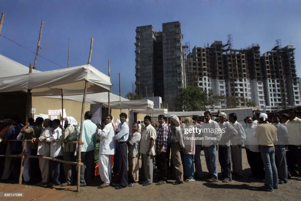 People wating in queue for BMC election at Kandivali Hindustan Naka on Thursday.