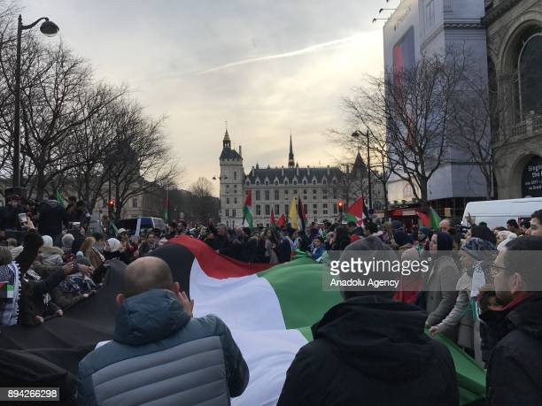 People wave a Palestinian flag during a protest against US President Donald Trumps announcement to recognize Jerusalem as the capital of Israel at...