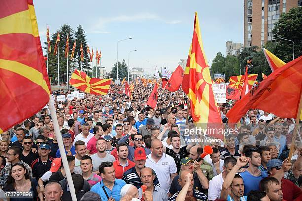 People wave Albanian and Macedonian flags during an antigovernment rally in Skopje on May 17 2015 More than 20000 people rallied in Macedonia's...