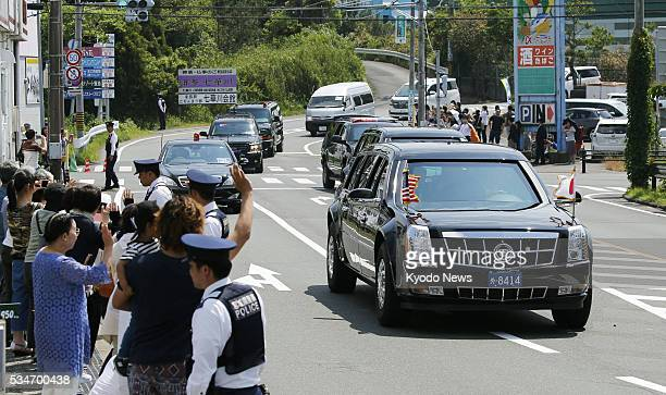 People wave at the motorcade of US President Barack Obama as he is driven to a heliport in the central Japan city of Shima on May 27 2016 Obama will...