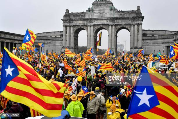 People wave Catalan 'Estelada' flags during a proindependence demonstration on December 7 2017 in Brussels Organised by proindependence civil society...