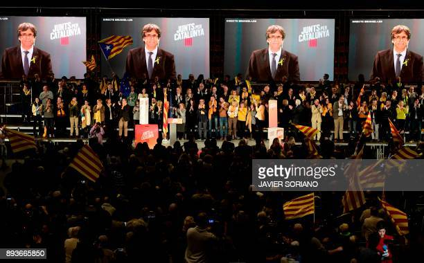 People wave Catalan flags as 'Junts per Catalonia' JUNTSXCAT grouping candidate for the upcoming Catalan regional election deposed regional president...