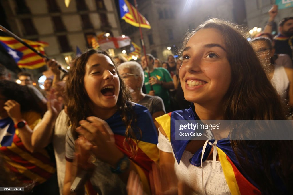 People wave Catalan independence flags after listening to a 9pm statement by Catalan regional president Carles Puigdemont while they gather in front of the Palau de la Generalitat de Catalunya, the building that houses the Catalonian presidency, following a demonstration for Catalan independence to demand the release of imprisoned Catalan leaders Jordi Sanchez and Jordi Cuixart on October 21, 2017 in Barcelona, Spain. The Spanish government announced measures today it will implement in triggering Article 155, which would lead to the imposition of direct rule by Spanish authorities in Catalonia and at least temporarily suspend the region's autonomy. The government also plans to hold Catalan regional elections in January. The moves come after Catalan regional President Carles Puigdemont let a Thursday deadline today pass and threatened to go forward with Catalan independence.