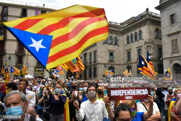 People wave Catalan pro-independence Estelada flags during a demonstration called by the Catalan National Assembly to demand politicians the...