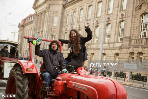 People wave during a march to demonstrate against the agroindustry on January 20 2018 in Berlin Germany Marchers whose protest is coinciding with the...