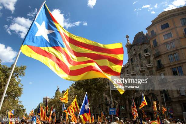 People wave Esteladas as they gather during a demonstration celebrating the Catalan National Day on September 11 2017 in Barcelona Spain The Spanish...