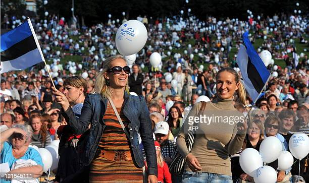 "People wave flags as they attend the concert ""Song of Freedom"" held for the 20th anniversary of Estonia's independence in Tallinn on August 20 2011..."