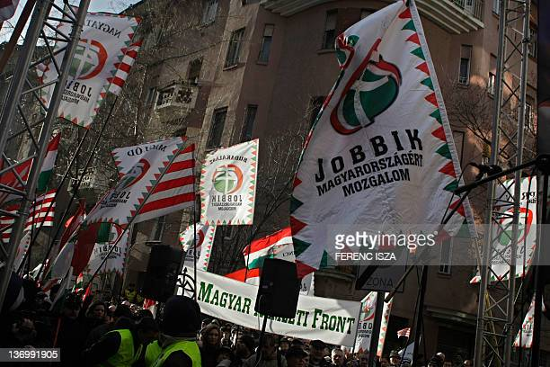 People wave flags during a demonstration untitled To be members or to be free and called by rightwing parliamental party 'Jobbik' against European...