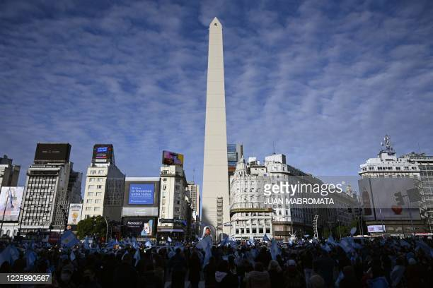 People wave flags during a protest against Argentina's President Alberto Fernandez health policies within the tight virus lockdown measures against...