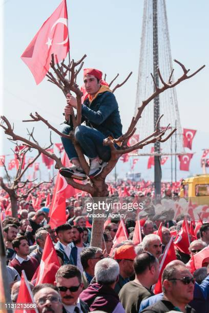 People wave flags during AK Party MHP campaign rally ahead of March 31 local elections in Izmir Turkey on March 17 2019