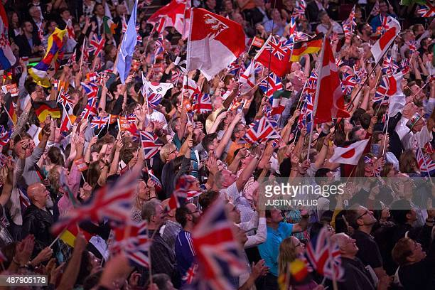 People wave flags from different nations during the last night of the Proms at The Royal Albert Hall in west London on September 12 2015 The...