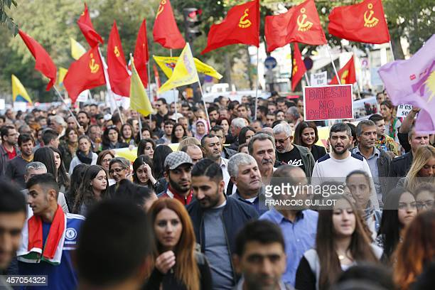 People wave flags of Marxist Leninist Communist Party of Turkey during a protest to show support to Kurdish people living in the Syrian town of...