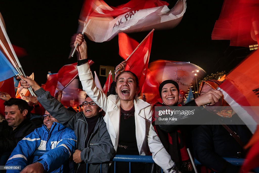 People wave flags outside the ruling AK Party headquarters after the party won a critical election after loosing a majority back in June on November 1, 2015, in Ankara, Turkey. Polls have opened in Turkey's second general election this year, with the ruling Justice and Development Party (AKP) hoping to win a majority, as the country searches for stability amongst serious security concerns.