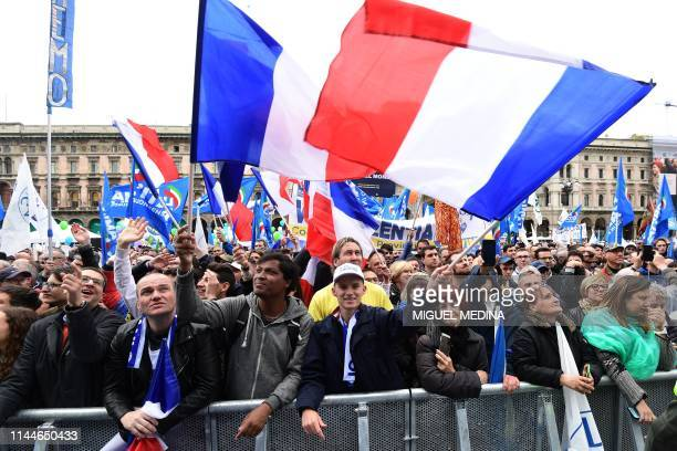 People wave French flags as they attend a rally of European nationalists ahead of European elections on May 18 in Milan The Milan rally hopes to see...