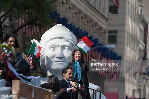 People wave Italian flags on a float in the annual Columbus Day Parade on October 10 2016 in New York City This is the 72nd Columbus Day Parade held...